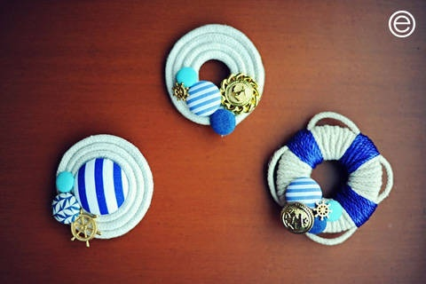 Boutonnieres with a hamptons theme, gold anchor and steering wheel trinkets