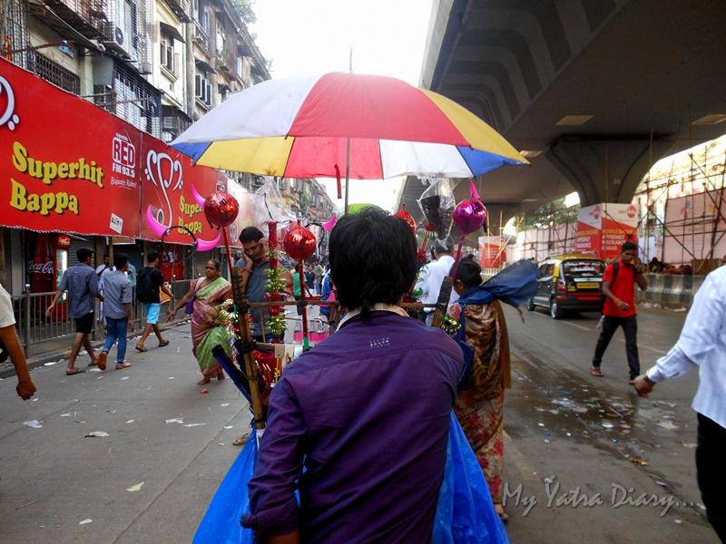 Toy seller on the way to Lalbaugcha raja, Ganesh Pandal Hopping, Mumbai