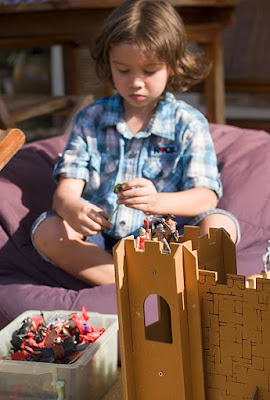 My Boy playing with wooden castle