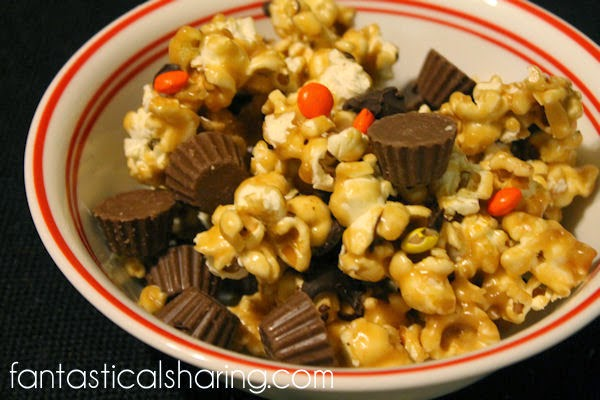 Reese's Peanut Butter Popcorn | A rich, decadent popcorn treat with honey and Reese's!