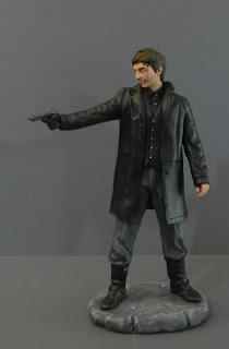 statuina personalizzata personaggio pistola da collezione cattivo orme magiche