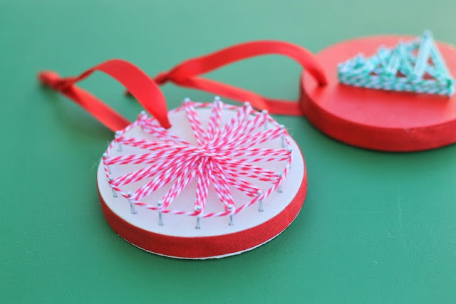 String Art Ornaments -- a fun and unique craft project to make with your kids this Christmas -- grab some wood and string to get started.