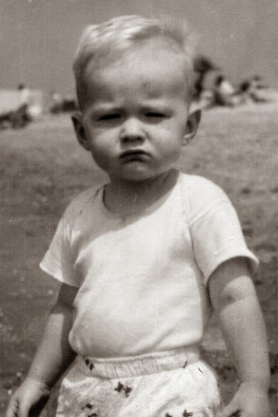 Opa enjoy the beach as a toddler.