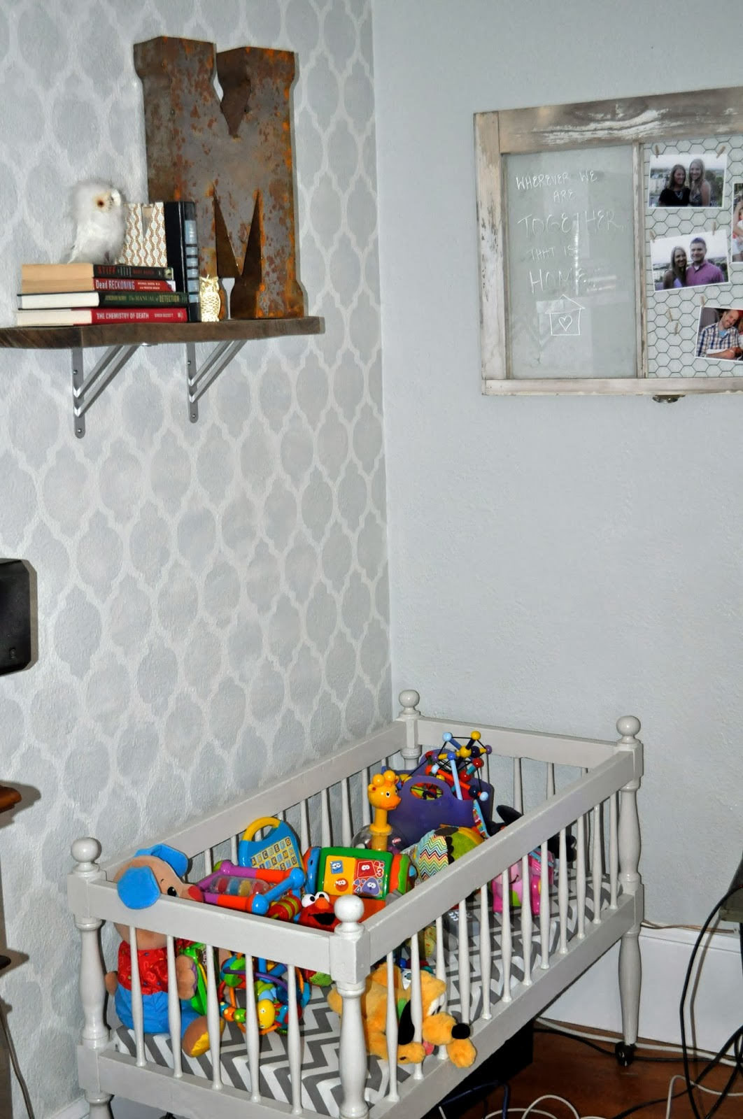 vintage industrial living room with baby crib toy storage