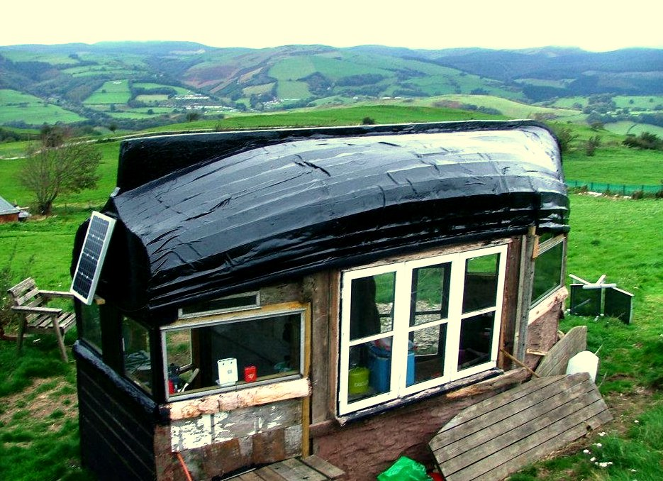 Pix grove boat roofed shed in wales for Shed roof tiny house