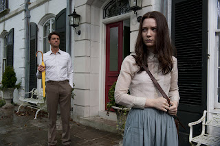 Mia Wasikowska as India, Matthew Goode as Charles, Charles stalk India, yellow umbrella, in Stoker (2013), Directed by Chan-wook Park