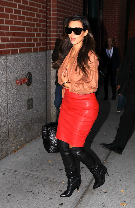 Kim Kardashian wearing red leather skirt
