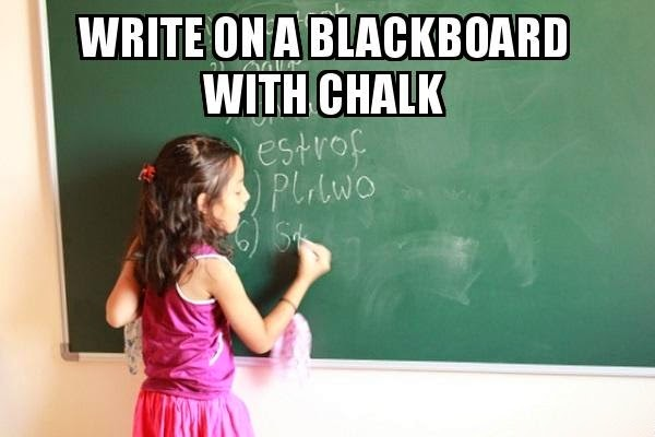 girl writing on a black board