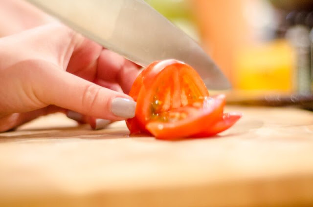 Slicing a tomato