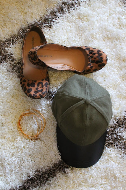 What I bought this month: Target leopard flats a baseball cap and a gold belt on a hammer and heels