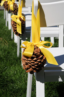 Pine cone aisle makers by Take the Cake Events