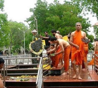 Devotees performing puja to Shani dev
