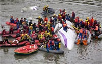 Death toll from TransAsia plane crash in Taiwan rises to 31