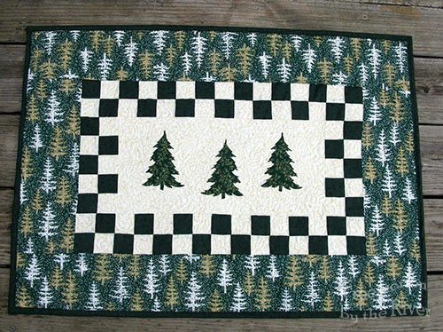 Evergreen trees table runner on deck at Freemotion by the River