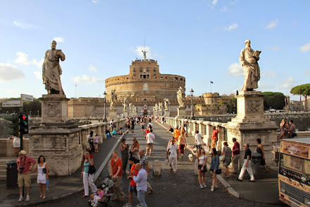 Crossing the Bridge of Angels in Rome