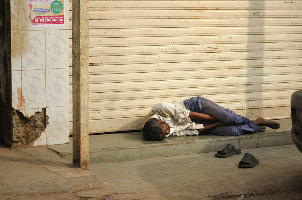 Photo of a man laying down in Mumbai, India.