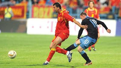 Rooneys-kick-at-Montenegros-Miodrag-Dzudovoic