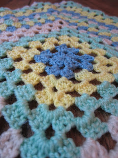 Close up of stitches on trad granny crochet blanket