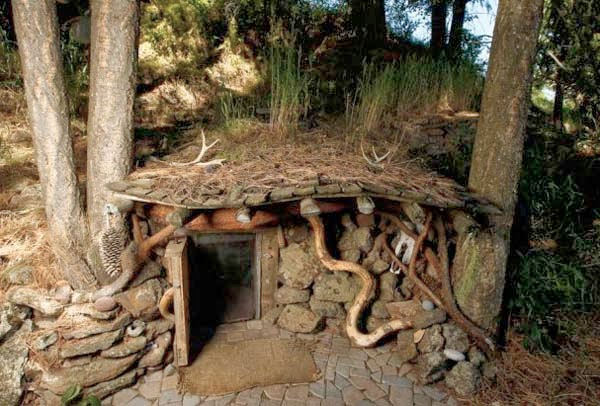 The small house is located in the ground, much like a hobbit's from The Lord Of The Rings.