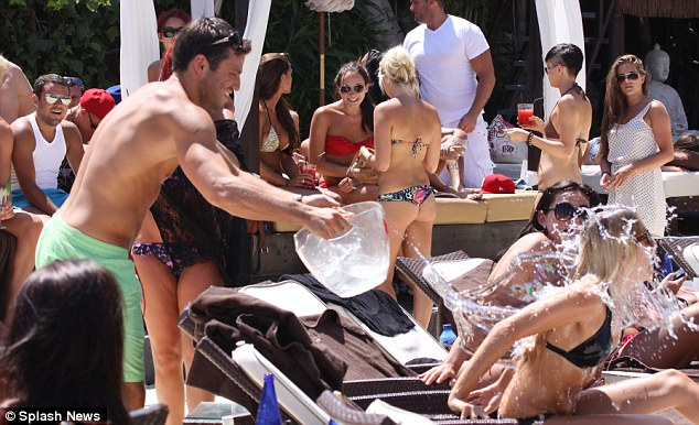 TOWIE BOYS: Mark Wright and James 'Arg' Argent get playful with a poolside water fight in Marbella with bikini-clad girls