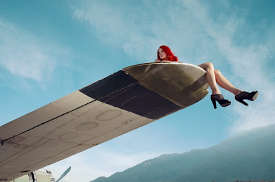 woman on airplane wing, fashion and beauty photographer nyc