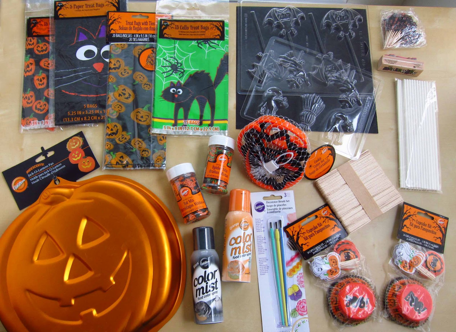 1 package halloween toothpicks 1 halloween rubber stamp 1 package extra long lollipop sticks 1 set craft sticks 2 packages halloween cupcake wrappers plus
