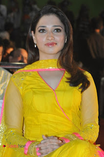 Tamanna Latest Pictures in Yellow Dress at Mr. Pelli Koduku Music Launch  0006.jpg