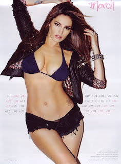 Kelly Brook wearing a bra and skimpy shorts