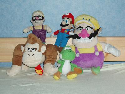 A collection of Mario-related soft toys.