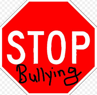 Stop sign with the word bullying underneath stop