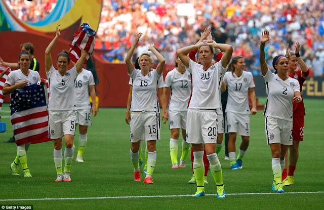 Team USA grasping flags clap their joyous fans in Vancouver after their incredible win