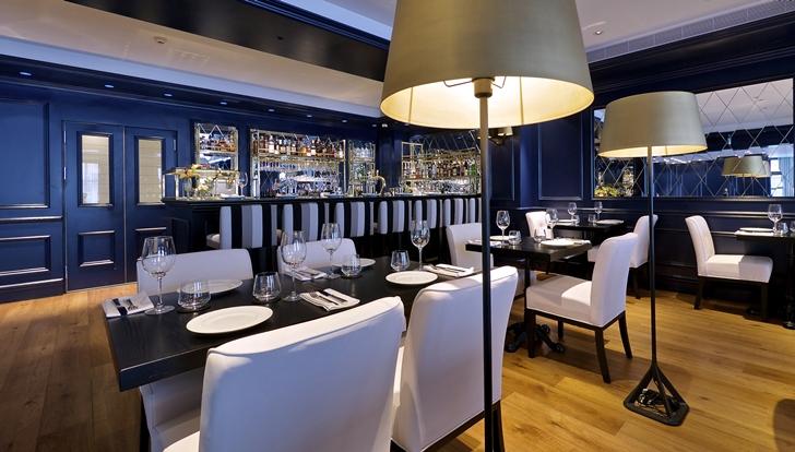 Dark interior design in restaurant in Hotel Indigo in Tel Aviv