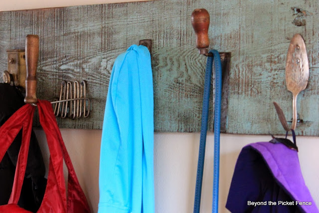 Repurposed Junk Coat Hook using a potato masher, pulley, trowel, door loock and cake server as hooks with reclaimed wood http://bec4-beyondthepicketfence.blogspot.com/2014/01/repurposed-junk-coat-hook.html