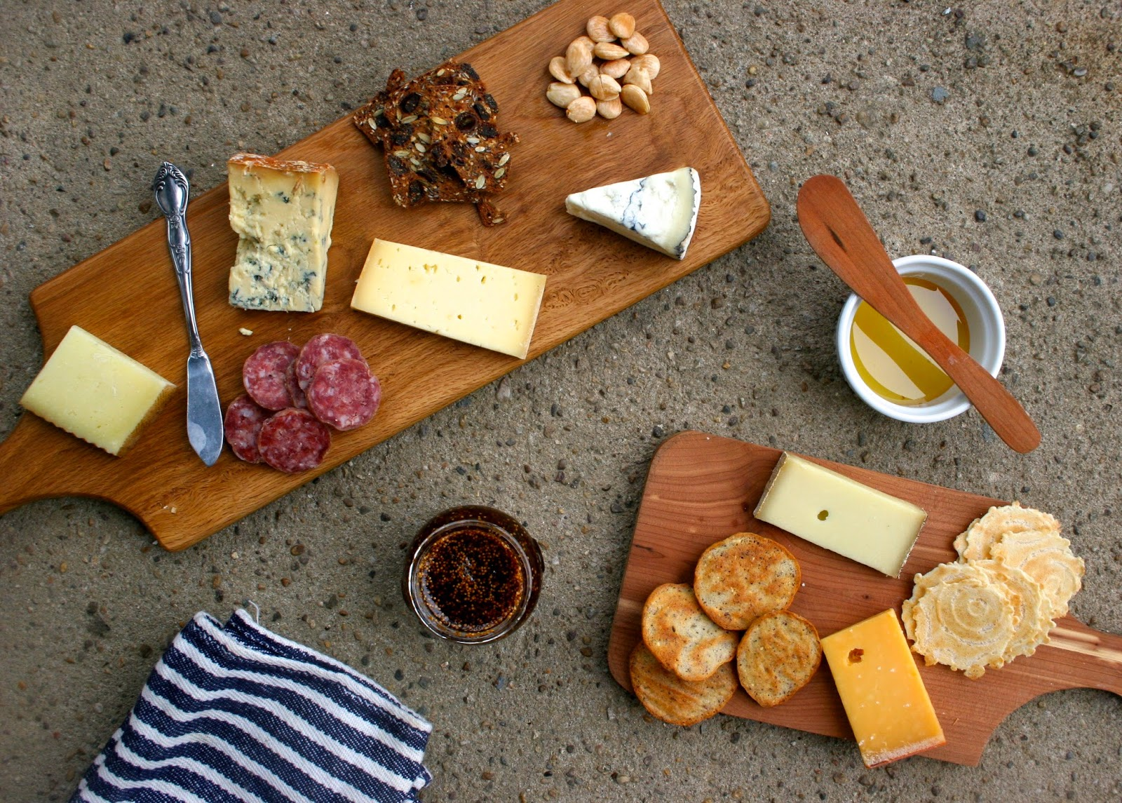 Cheese Plate with Salami, Almonds, Fig Jam, and Homemade Crackers