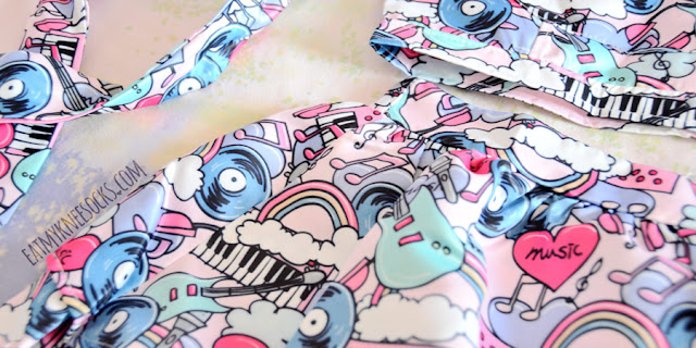 Close-up of the cute, pastel pop art print on the Harajuku graffiti crop top and skirt set from Romwe.