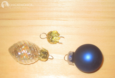 Christmas ornament caps can be inserted in the holes on the end of blown, decorated eggs