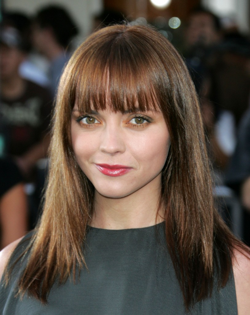 curly hairstyle with bangs - Fringe Bangs Hairstyle for Round Face