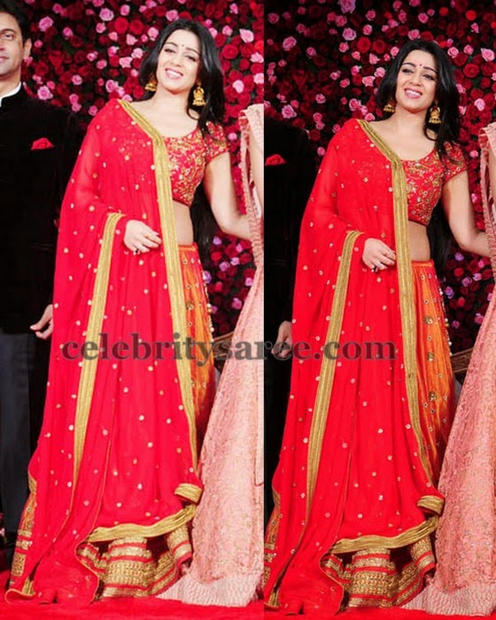 Charmi in Orange Silk Lehenga