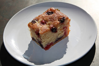 A slice of blueberry and raspberry lime drizzle cake