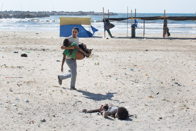 dead body of a child and a person running with a injurd child
