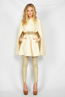 Vintage 1960's cream colored wool military swing cape with gold buttons and front pockets.