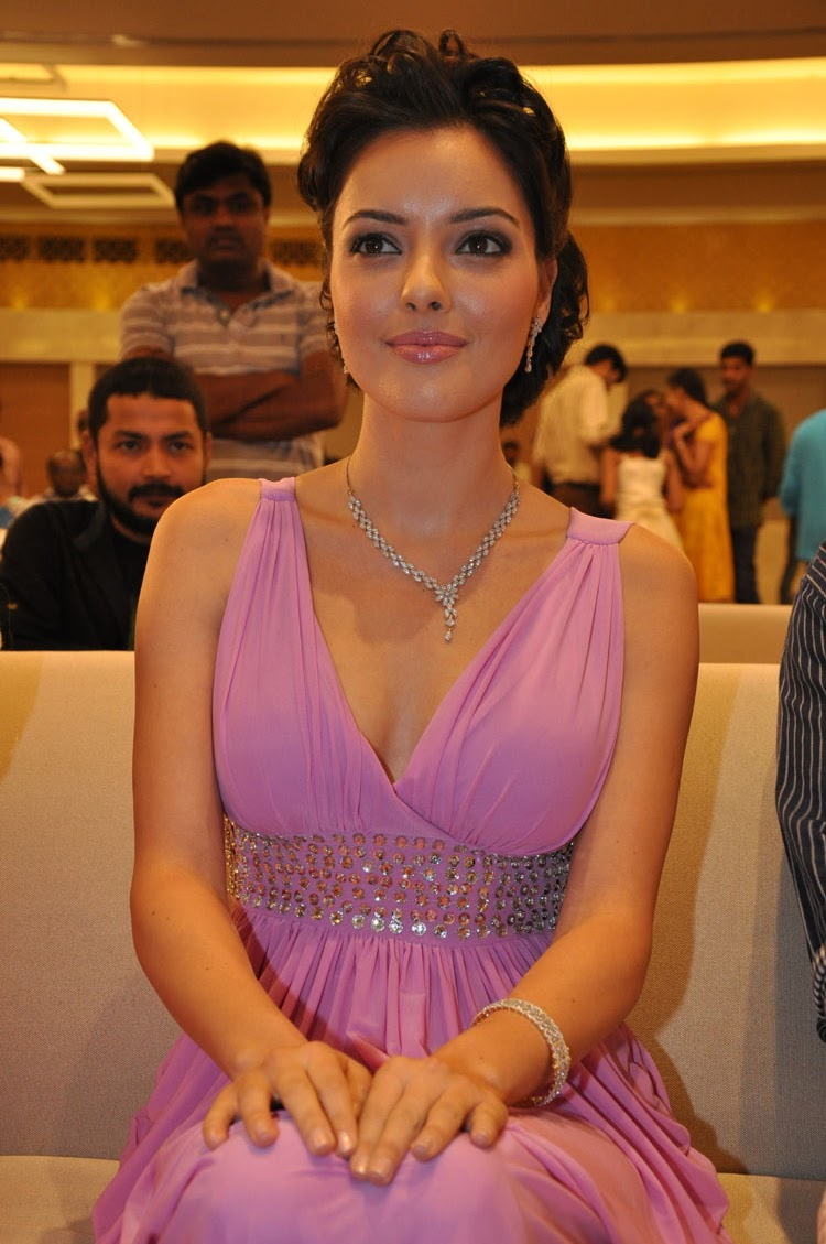 "Kristina Akheeva Super Sexy Cleavage Show In A Sexy Low Neck Dress At Telugu Film ""Upendra 2″ Audio Release Event In Hyderabad"