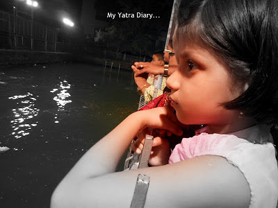A small girl watching her Ganpati ahead of Ganesh Visarjan - Mumbai