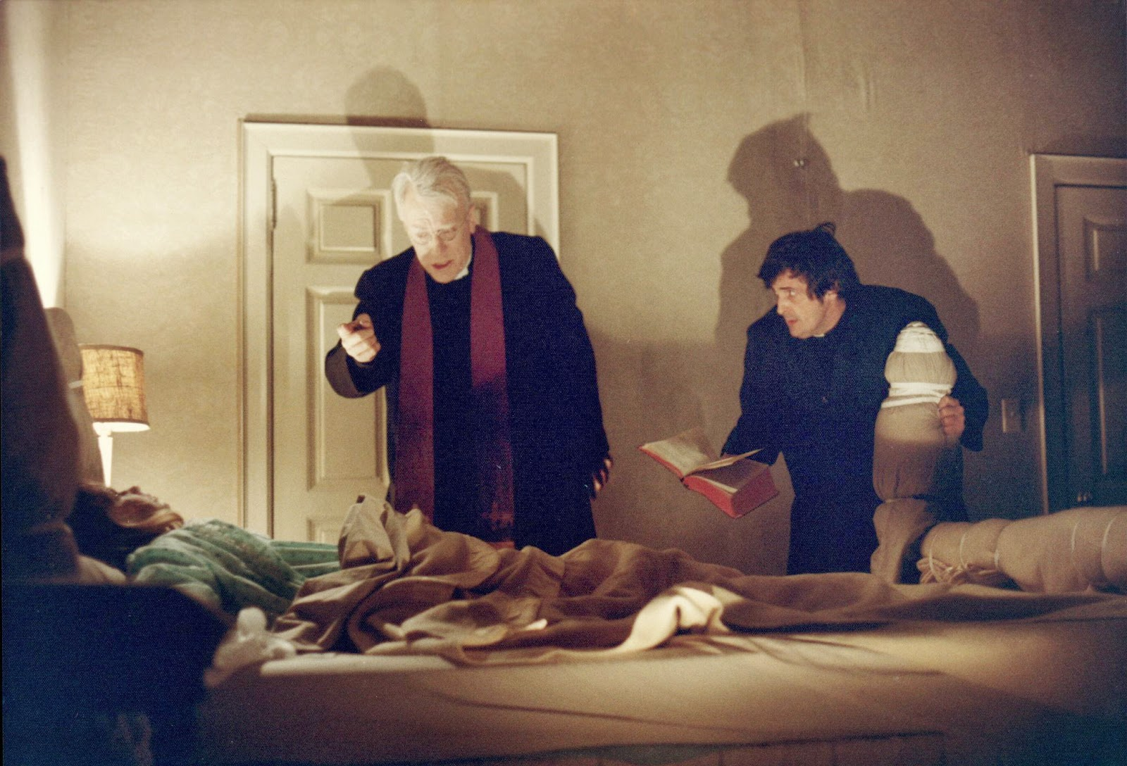 still-of-linda-blair,-max-von-sydow-and-jason-miller-in-the-exorcist-(1973)-large-picture.jpg