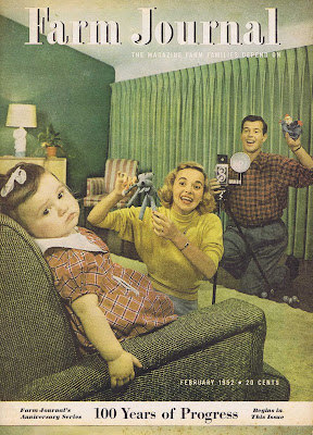 The cover of Farm Journal Magazine, February 1952, with a mother and father trying to coax a toddler into smiling for the camera.