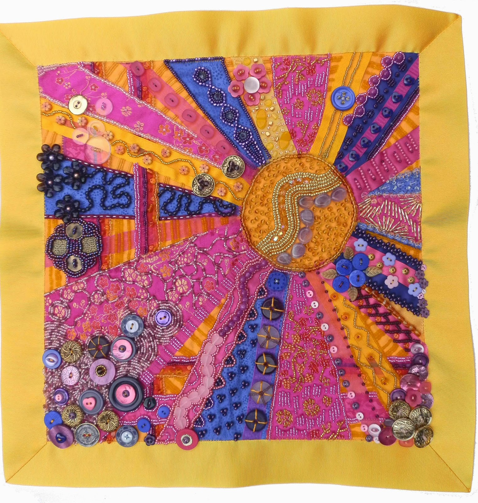 Orange pink and purpled beaded quilt embroidery in sunburst design