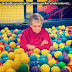 unhappy grandma in ball pit