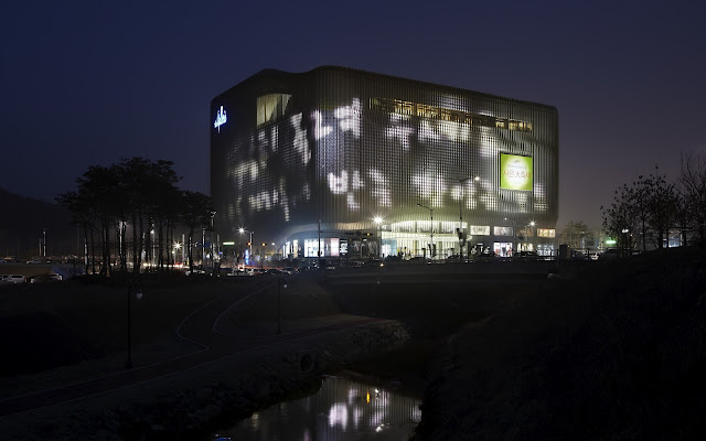 Photo of new building as seen at night with beautiful lights on facade