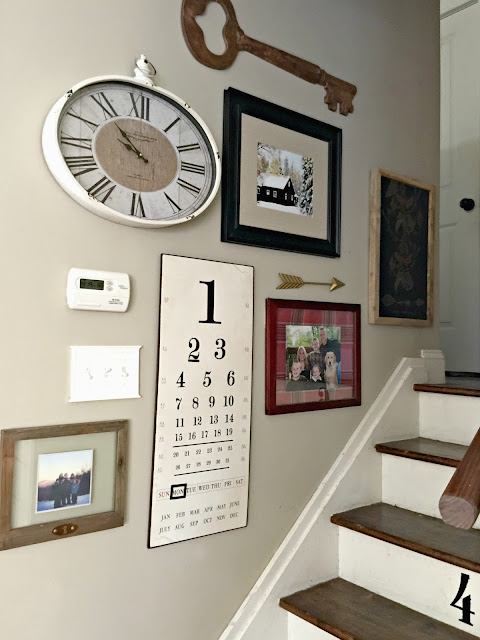 Gallery wall up the stairs - www.goldenboysandme.com