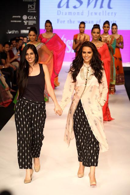 Neha Dhupia and Ankita Shorey walk the ramp for Gitanjali Group at IIJW 2012